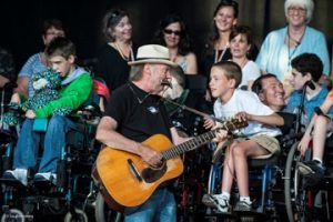 Neil Young playing music for children